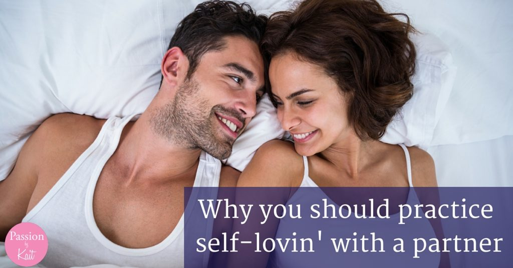 Two people laying next to each other in bed with their heads touching and smiles on their faces.   Photo for 6 Reasons to Try Mutual Masturbation - Why Masturbate Together