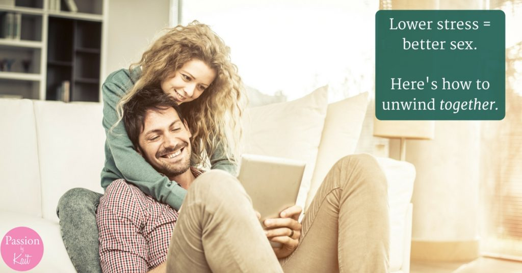 Two people smiling and cuddling while watching something on a tablet. How to Deal with Stress in a Relationship- Unwind Together | Passion by Kait