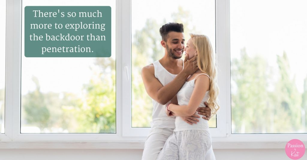 Couple standing in front of a window with their arms around each other. | This Is What You Need to Know About Anal Play - Anal Sex 101 - Passion by Kait
