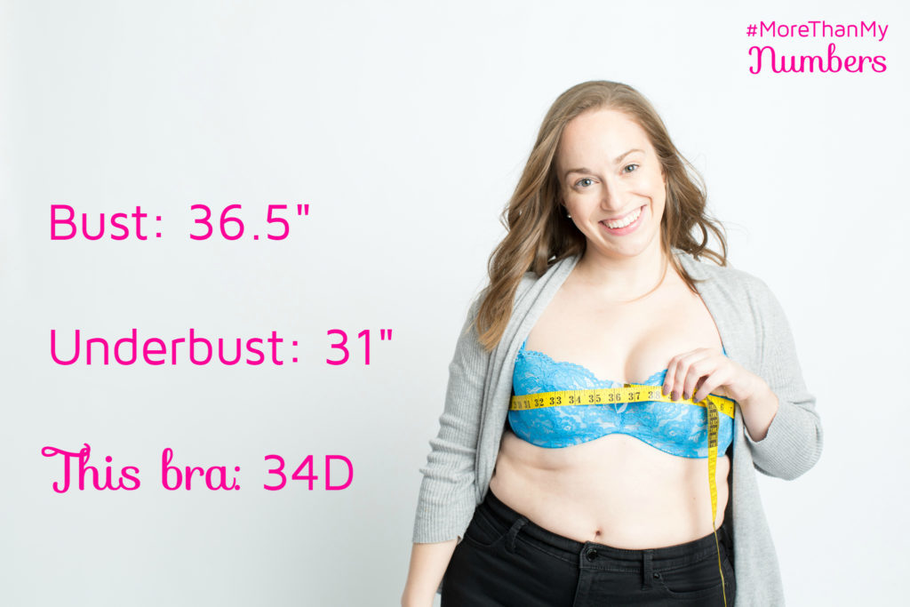 """Photo of a smiling person in a bra with a tape measure around their bust. Measurements on the side read bust: 36.5"""", underbust: 31"""", and this bra: 34D. 
