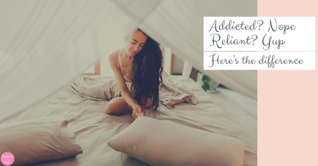 Person sitting on a canopy bed surrounded by pillows with their hair cascading over their shoulder. | Can I become addicted to my vibrator? | Passion by Kait
