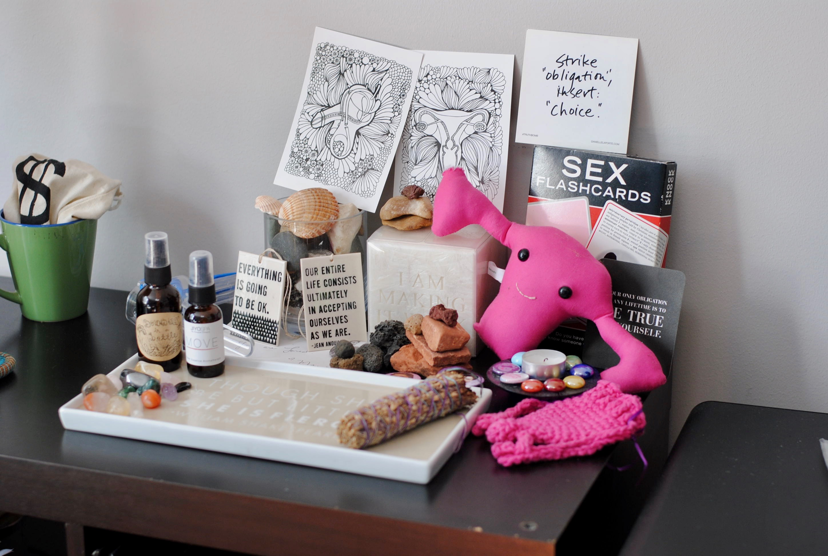 Altar with a stuffed uterus, sex flashcards, coloring sheets of a penis and uterus, crystals, inspirational sayings, and more. | Sex Counseling NYC - Couple's Counseling NYC | Passion by Kait