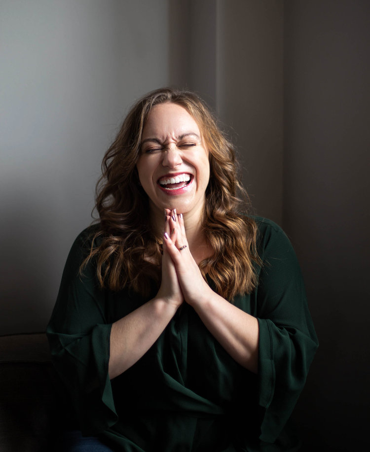 Laughs abound at our sex classes! Our founder, Kait, laughs and claps. |  Sex Classes NYC and Beyond - Passion by Kait
