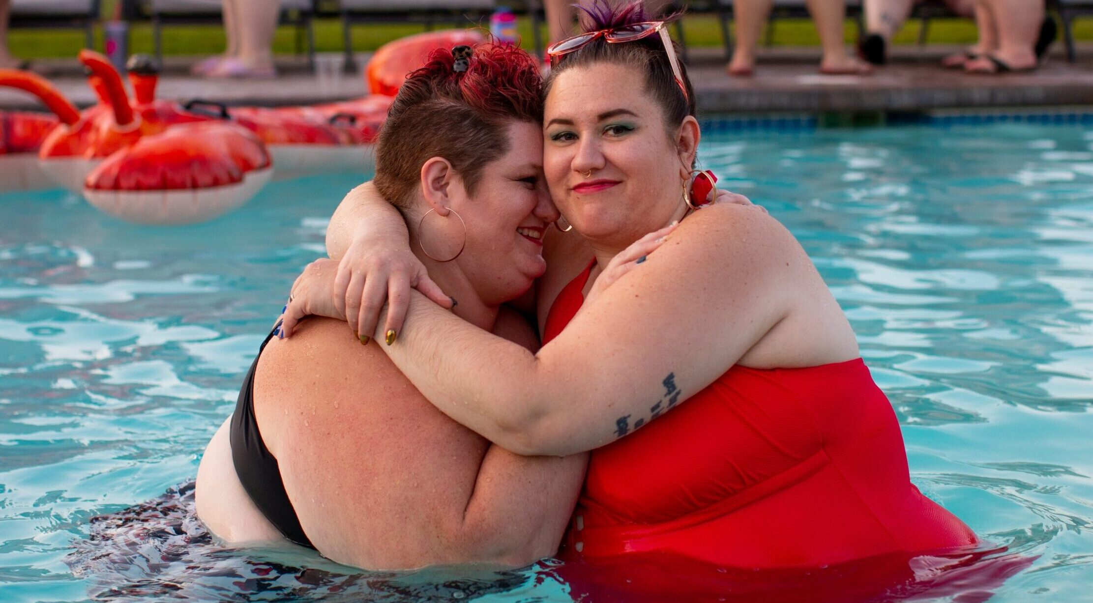 Two people hugging and smiling in a swimming pool, wearing swimsuits | These are the Only 3 Things You Need to Have Better Sex for a Lifetime | Passion by Kait